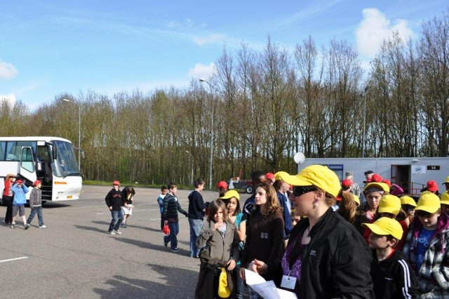 They came by bus Students representing Australia, Canada, Czech Republic, Denmark, Finland, the former Yugoslav Republic of Macedonia, Norway, Republic of South Africa, Turkey, United Kingdom and the United States arrive from AFNORTH International High School, Brunssum, Netherlands; Geilenkirchen Elementary School, NATO Air Base, Geilenkirchen, Germany; and Kleine Brogel Elementary School, Kleine Brogel, Belgium (From locations much too far to bicycle or walk).