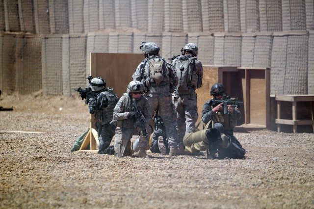 Iraqi Security Forces and Soldiers of B Troop, 5/7 Cav., 1st AAB, 3rd ID, demonstrate a partnered assault at the small arms range on Contingency Operating Station Falcon, April 15.