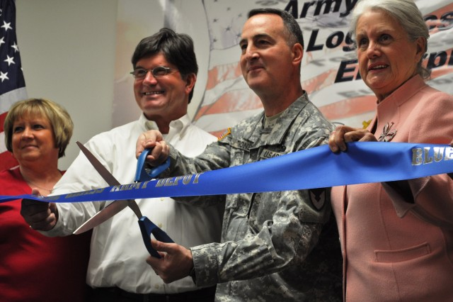 On March 25, Col. Joseph Tirone, Blue Grass Army Depot commander, and a Blue Grass Army Depot employee are joined by Connie Lawson, mayor, Richmond and Kent Clark, judge executive, Madison County as they prepare to cut the ribbon opening the depot's latest training facility, the Learning Center.