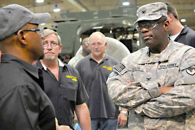 Fuller tours Stryker facility in Qatar