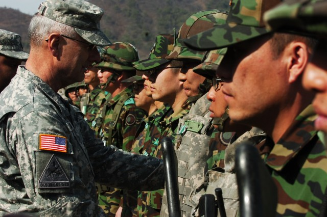 Maj. Gen. Michael S. Tucker, 2nd ID commander, shakes the hands of Republic of Korea Army Soldiers from 75th Mech. after the CALFEX conducted April 15.