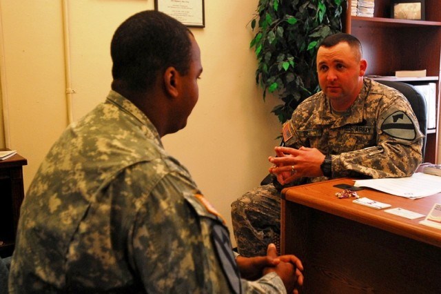 FOR HOOD, Texas-Sgt. 1st Class Robert Bee (right), a Rochester, Minn. native and an equal opportunity advisor for 2nd Brigade Combat Team, 1st Cavalry Division, talks with Spc. Darrell Robinson, a Pittsburg native and an infantry Soldier with A Company, 1st Battalion, 5th Cavalry Regiment, 2nd BCT, about his life since returning to Texas from Iraq. Talking to Soldiers is one of Bee's most important jobs as the EOA.