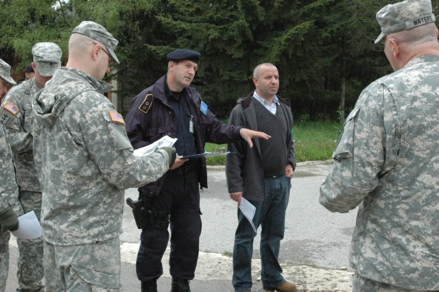 Lt. Naser Rrahmani, chief of operations for the Gjilan/Gnjilane Kosovo Police Service, explains the role that is planned for the KP and EULEX in an upcoming June joint exercise with Soldiers from KFOR's Multinational Battle Group East, at Camp Montieth in Gjilan/Gnjilane, Kosovo.