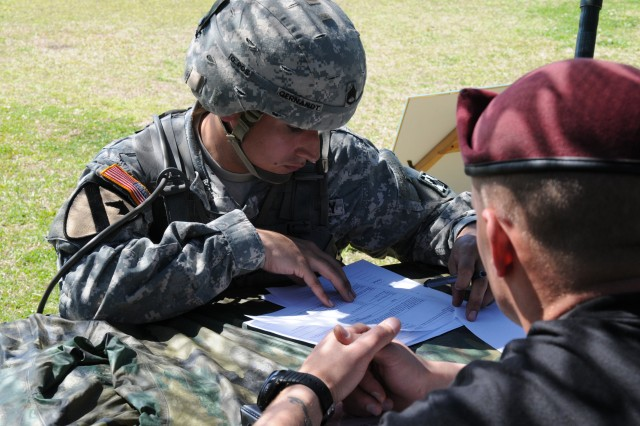 Staff Sgt. Loren A. Gernandt, Headquarters and Headquarters Company, 20th Engineer Brigade, completes a warrior task as part of the XVIII Airborne Corps Noncommissioned Officer of the Year competition March 31.