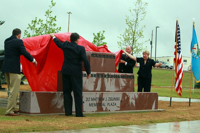 """The brothers and sister of 2nd Lt. Matthew Zielinski unveil his memorial April 16, 2010, at the new Air Defense Artillery brigade complex at Fort Sill. The inscription on the memorial reads: """"Hope, Promise, Potential"""" -- which summed up the brief life of the ADA officer, who died at age 23."""