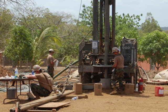 Three U.S. Navy constructionmen with Naval Mobile Construction Battalion 25, out of Ft McCroy, Wis. work on a water well drilling project in Samaria, Nicaragua for U.S. Army South's Beyond the Horizon 2010. (U.S. Army photo by 2nd Lt. Robert Lee/RELEASED)