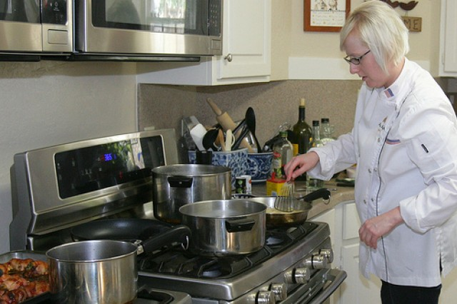 With five pots and pans simmering on the stoves, Sgt. Alicia Hight grapples with a few of the components of her five-course dinner menu at Sherman House.
