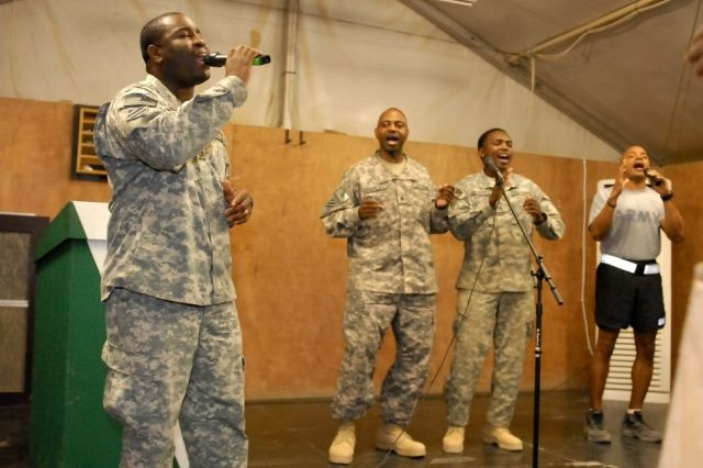 Soldiers assigned to the 3rd Heavy Brigade Combat Team, 3rd Infantry Division, sing songs of worship during a Christian men's conference at Contingency Operating Site Kalsu, Iraq, April 10. The three-day conference was an opportunity for the Christian men to speak with one another about the issues they are facing during their current deployment and help one another come up with faith-based answers.