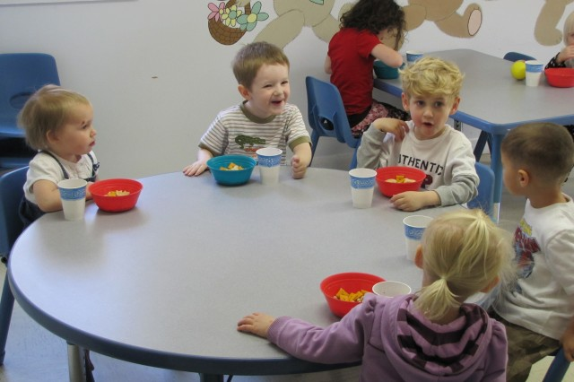 From left, Clara Ottum, Dennis Andrews, William Case, Jacob Kasmarski and Ellie Case share a laugh over snack time at ChildWise.