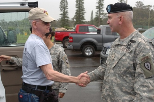 Brig. Gen. James C. Nixon, deputy commanding general (operations), 25th Infantry Division, and former 75th Ranger Regiment commander, greets Ron Harrison April 21 on Schofield Barracks, Hawaii. Harrison served with Company F, 50th Inf. Long Range Patrol, 75th Inf. (Ranger) Regiment, which was attached to the 25th Inf. Div. in Vietnam. Nine Vietnam veterans from Co. F and their wives toured the base, observed Soldiers participating in the division's Best Warrior Competition and ate lunch with Soldiers in a dining facility during their visit.