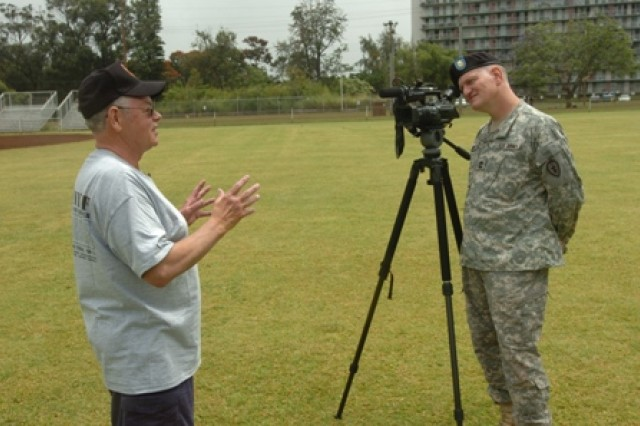 Colin Hall gives a brief oral history of some of his experiences in Vietnam to Master Sgt. Michael Wetzel, 25th Infantry Division Public Affairs, April 21 at Schofield Barracks, Hawaii. Hall served with Company F, 50th Inf. Long Range Patrol, 75th Inf. (Ranger) Regiment, which was attached to the 25th Inf. Div. in Vietnam. Nine Vietnam veterans from Co. F and their wives toured the base, observed Soldiers participating in the division's Best Warrior Competition and ate lunch with Soldiers in a dining facility during their visit.