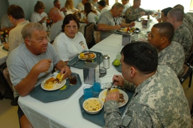 Robert Byrd and his wife, Teresa, have lunch with Soldiers at a dining facility on Schofield Barracks, Hawaii, April 21. Byrd served with Company F, 50th Infantry Long Range Patrol, 75th Inf. (Ranger) Regiment, which was attached to the 25th Inf. Div. in Vietnam. Nine veterans from Co. F and their wives toured the base, observed Soldiers participating in the division's Best Warrior Competition and ate lunch with Soldiers during their visit.