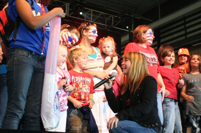 Children were invited on stage to sing with members of the Lt. Dan Band during a concert at Fort Riley to celebrate the Month of the Military child.