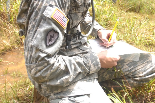 Sgt. Colin Whyte, a health care NCO with 2nd Battalion, 11th Field Artillery Regiment, 2nd Brigade Combat Team, 25th Infantry Division (top), and a native of Barkhamsted, Conn., plots an azimuth for land navigation during the 25th Inf. Div.'s Best Warrior Competition on Schofield Barracks, April 22. Soldiers and Noncommissioned Officers representing their units performed a variety of events during the competition held April 19-22, including taking an Army Physical Fitness Test, reflexive firing an M-4 rifle, completing common Soldier tasks, and appearing before a board.