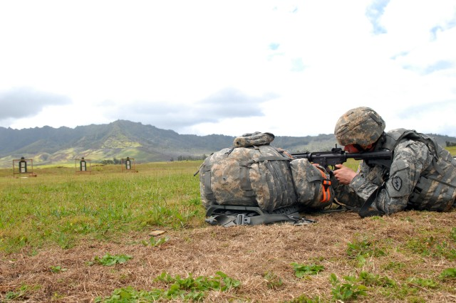 Sgt. Devon A. Setzer, a combat engineer with Headquarters and Headquarters Company, 25th Special Troops Battalion, 25th Infantry Division, and a native of Portland Ore., fires an M-4 rifle during the division's Best Warrior Competition on Schofield Barracks, Hawaii, April 20. Soldiers and Noncommissioned Officers representing their units performed a variety of events during the competition held April 19-22, including taking an Army Physical Fitness Test, completing common Soldier tasks, and appearing before a board.