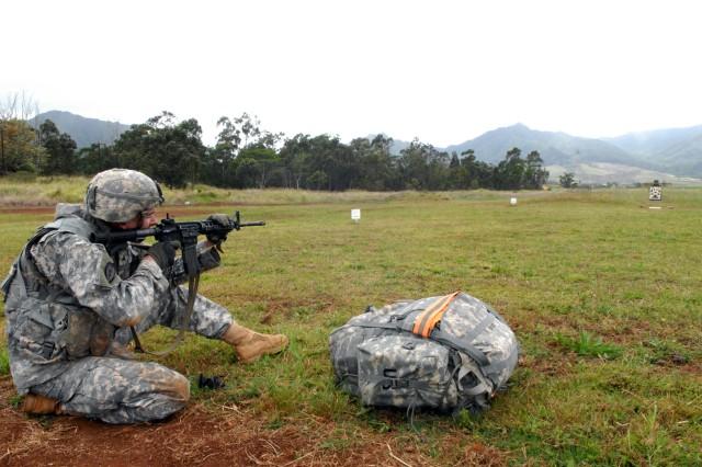 Firing M-4 rifle