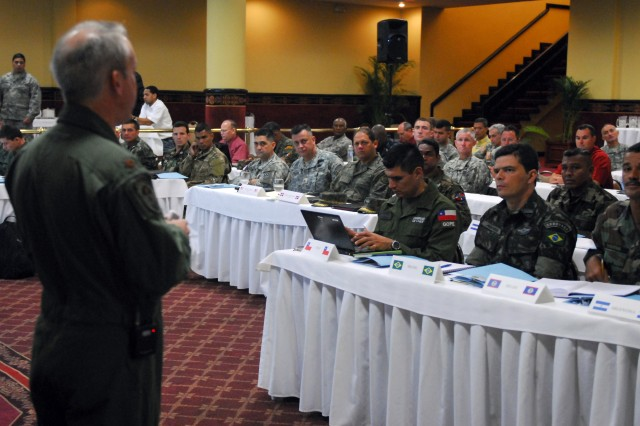 SANTO DOMINGO, DOMINICAN REPUBLIC (April 23, 2010) - (Left) Air Force Maj. Brett Phillips briefs members of the Dominican Army and servicemembers assigned to Special Operations Command South April 23 during the final planning conference for Fuerzas Comando 2010 in Santo Domingo, Dominican Republic. Senior leaders from both the U.S. and Dominican militaries were working together in order to finalize all coordination efforts for the exercise.  FC 10, the SOCSOUTH-sponsored annual Special Forces skills competition, will be held in the Dominican Republic this year. The event helps promote interoperability, security and military partnerships throughout the Americas. More than 20 nations will be participating in this year's event. (U.S. Army photo by Sgt. 1st Class Alex Licea, SOCSOUTH PAO)