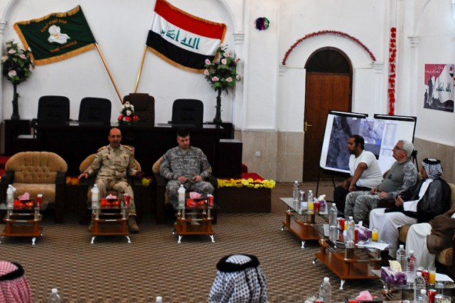 Lt. Gen. Muhammad Jawad Hawaydi, Basrah Operations Center commander and Col. Steven Bullimore, 17th Fires Brigade commander (center) discuss key issues with the tribal leaders from several districts in Basrah, Iraq, April 18, 2010.
