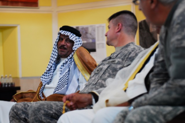 Shaykh Sbieh Al Kramshy (left), discusses issues in his district with Col. Steven Bullimore, 17th Fires Brigade commander during a key leader engagement held at the Basrah Operations Center in Basrah, Iraq, April 18, 2010.