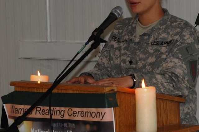 Spc. Elizabeth Peterson reads names of victims from the Holocaust during the Days of Remembrance observances, April 12-14, at Contingency Operating Base Basra, Iraq.  Peterson, from Decatur, Ala., is a signal support systems specialist, Signal Company, Division Headquarters and Headquarters Battalion, 1st Infantry Division, is a volunteer vocalist for the division's band.