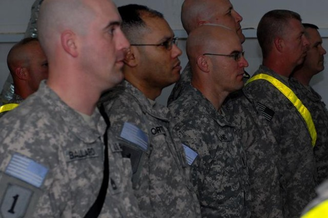 First Infantry Division Soldiers participate in the Days of Remembrance Commemorative Service in the town hall at Contingency Operating Base Basra, Iraq, April 14, 2010.