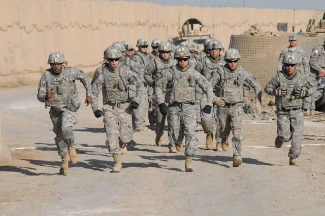 Soldiers representing 2nd Battalion, 69th Armor Regiment, 3rd Heavy Brigade Combat Team, 3rd Infantry Division, start out on a 5-mile march April 15, 2010, during the best-squad competition at Contingency Operating Site Kalsu, Iraq. The competition tested the teamwork and physical abilities of teams representing the Sledgehammer Brigade's six battalions.