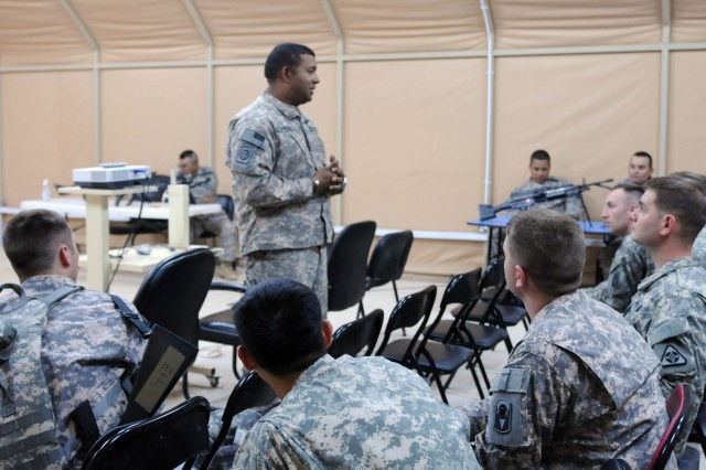 Sgt. Major William Sanchez, operations sgt. major for 1st Battalion, 124th Infantry Regiment at Camp Buehring, Kuwait, speaks to some of the newly activated Inactive Ready Reserve Soldiers brought to the 53rd Infantry Brigade Combat Team, Tuesday, April 13th. Sanchez welcomed the Soldiers and said he wanted to make their transition into the battalion as smooth as possible. (Photo by Army Spc. Spencer Rhodes)