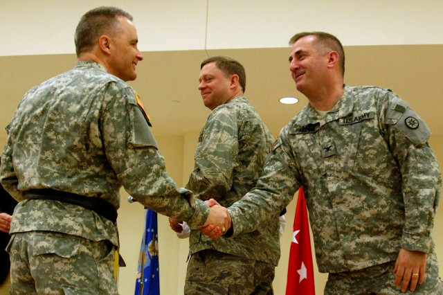 CHICOPEE, Mass. (April 25, 2010)- Army Maj. Gen. William Monk III, commanding general of the 99th Regional Support Command, Fort Dix, N.J., and Col. Stephen Falcone, commander of the 655th Regional Group, shake hands at the close of the Westover Armed Forces Reserve Center ribbon cutting ceremony  here on Sunday, April 18h, 2010. (US Army photo by Spc. Peter C. Jun, 361st Public Affairs)