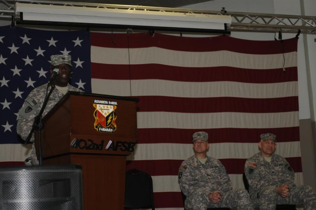 Col. Larry Fuller, the incoming commander of the 402nd Army Field Support Brigade and a Jackson, Ala., native, speaks to the audience during the change of command ceremony April 21 at Morale, Welfare and Recreation east at Joint Base Balad, Iraq.