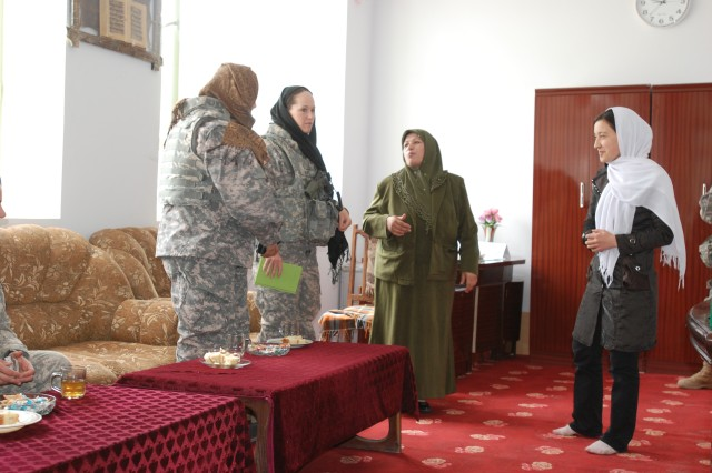 (Left to right) Fatima Younoszai, a FET linguist who was born in Kabul, Afghanistan; Capt. Lisa Kirby, the commander and leader of the FET, 1st Brigade Combat Team, 10th Mountain Division; Breshana Karamat, the principal; Rabai Balkhaey Fatima and Noria, a 17 year-old senior, Rabai Balkhaey Fatima, meet in the principal's school office in Mazar e Sharif, Afghanistan, April 21.