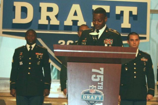 Sgt. 1st Class Marc Pierre, Mid-Atlantic Recruiting Battalion, announces the 159th draft pick during Round 5 of the 75th NFL Draft April 24.
