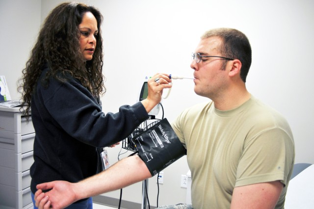 PRESIDIO OF MONTEREY, Calif. - Julie Gonzalez-Rivera, CALMED medical assistant, checks the blood pressure and temperature of Airman 1st Class Derek Elliott with the up-to-date medical equipment that was a part of the $22 million renovation to the Presidio clinic.