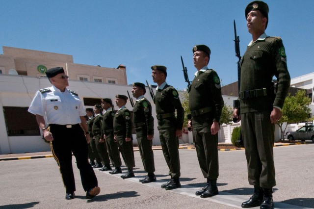 Chief of Staff of the Army Gen. George W. Casey Jr. conducts a pass and review of Jordanian Soldiers at the Royal Jordanian National Defense College in Amman, Jordan, April 25, 2010.