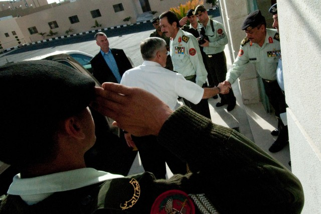 Chief of Staff of the Army Gen. George W. Casey Jr. shakes hands with a senior Jordanian Army officer outside Jordan's Ground Forces Headquarters after a meeting with military officials in Amman, Jordan, April 25, 2010.