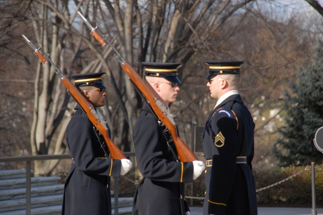 Pfc. Rikki Reed (left) and Spc. Joseph Hull change guard duties at the Tomb of the Unknowns.