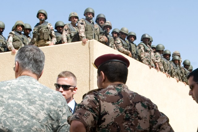 Jordanian Soldiers wait to begin training while Chief of Staff of the U.S. Army Gen. George W. Casey Jr. is given a brief on the training facility's capabilities of a military compound outside of Amman, Jordan, April 26, 2010.