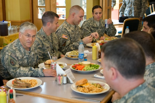 Chief of Staff of the Army Gen. George W. Casey Jr. has lunch with Soldiers and Airmen stationed  in Amman, Jordan, April 26, 2010.  Casey took questions and offered the attendees an update on current operations.