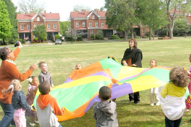 Children challenge themselves to see how high they can launch a ball into the air.