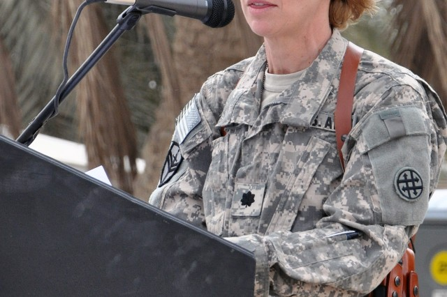 Lt. Col. Giulia Giacoppe, commander of the 373rd Combat Sustainment Support Battalion, 15th Sustainment Brigade, 13th Sustainment Command (Expeditionary), and a Sugarland, Texas native, speaks at a transfer of authority ceremony with the outgoing 260th CSSB in front of the battalion's headquarters here, April 22. (U.S. Army photo by Staff Sgt. Matthew C. Cooley, 15th Sustainment Brigade public affairs)