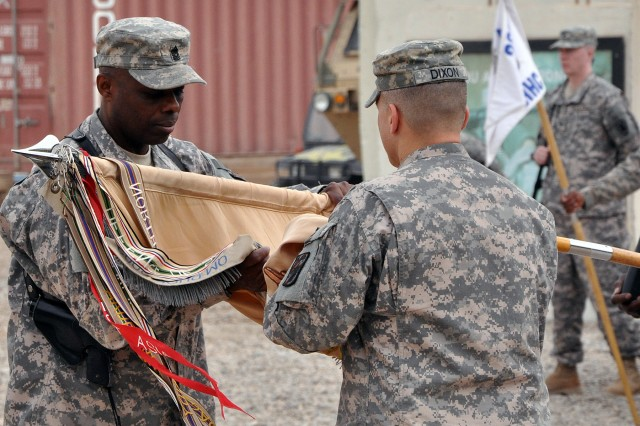 Sgt. Maj. Dwight Williams, command sergeant major of 260th Combat Sustainment Support Battalion, 15th Sustainment Brigade, 13th Sustainment Command (Expeditionary), from Savannah, Ga., and Lt. Col. Joe Dixon, the unit's commander and a Frankfort, Ind., native, case their unit's colors at a transfer of authority ceremony with the incoming 373rd CSSB in front of the battalion's headquarters here, April 22. (U.S. Army photo by Staff Sgt. Matthew C. Cooley, 15th Sustainment Brigade public affairs)