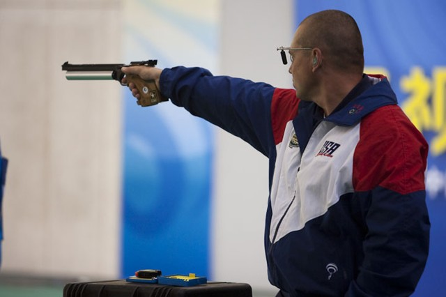 Sgt. 1st Class Daryl Szarenski, U.S. Army Marksmanship Unit, fires a round during the Men's 50m Free Pistol finals April 19 at the China World Cup. Szarenski won the event and left China with two gold medals.
