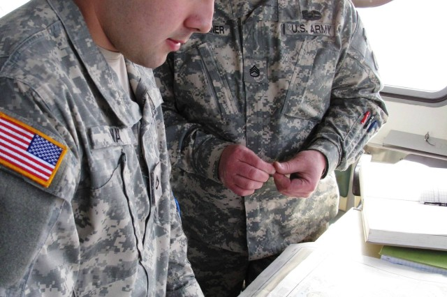 Pfc. Joshua Way, left, and Staff Sgt. Daniel Kartchner of the 467th Transportation Company chart <i>Knox's</i> course through Puget Sound.