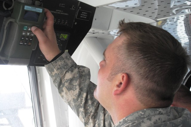 Staff Sgt. Jason Trusky of the 467th Transportation Company checks <i>Knox's</i> course with a global positioning system unit mounted in Knox's wheelhouse