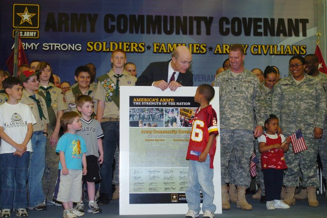 Secretary of the Army Pete Geren is joined by members of the Fort Drum and northern New York communities in signing the Army Community Covenant in Watertown, N.Y., May 9, 2008. The Army Community Covenant signifies the commitment of the local community to continue its tradition of strong support to Fort Drum Soldiers and their Families.