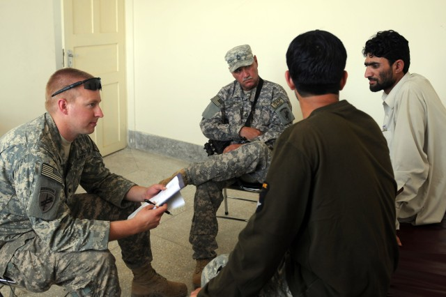 KUNAR PROVINCE, Afghanistan - U.S. Army Spc. Jacob D. Gates, a medic with the 405th Civil Affairs Battalion, Task Force Ute, and Master Sgt. Andrew Malkogainnis, the noncommissioned officer in charge of the public health functional specialty team, with the 405th Civil Affairs Bn., conduct an assessment of the Fateme Comprehensive Medical Clinic during a village medical outreach in the Noorang District of eastern Afghanistan's Kunar province, April 19. Their units, members of 1st Platoon, Company A, 2nd Battalion, 503rd Infantry Regiment, Task Force Rock, local healthcare providers and the Afghan provincial government worked together to organize and execute he VMO. (Photo by U.S. Army Spc. Albert L. Kelley, 300th Mobile Public Affairs Detachment)