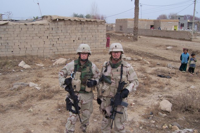 Then Spc. Michael Schettino and Command Sgt. Maj. Jeffrey Mellinger served together in Iraq from 2005-2006.
