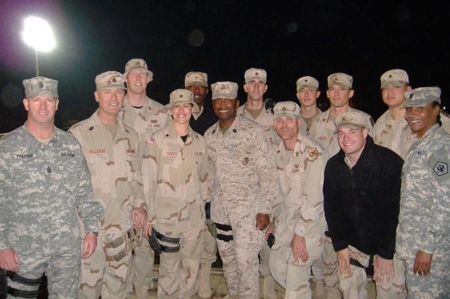 "Sgt. Maj. of the Army Kenneth O. Preston, Command Sgt. Maj. Jeffrey Mellinger, the Aca,!A""Lion 7Aca,!A? crew, Sgt. Maj. of the Marine Corps John L. Estrada and Command Sgt. Maj. Michele Jones met in Baghdad in December 2005."