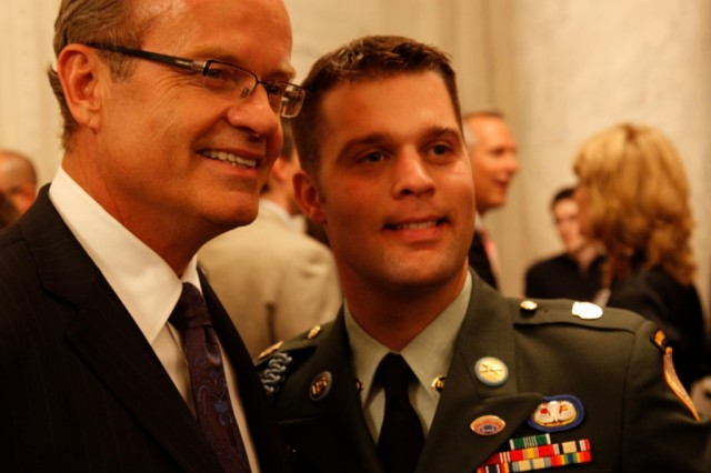 Actor Kelsey Grammer poses with a Soldier at the GI Film Festival's congressional reception to honor servicemembers in 2009.