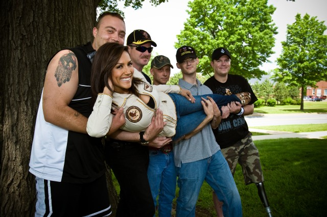 Model and TV host Leeann Tweeden hangs with wounded warriors at Bolling Air Force Base, Md., at a 2008 GI Film Festival event.