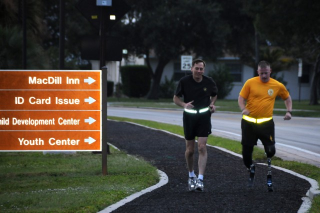 1st Lt. Brian Brennan (right) goes for a run with Gen. David Petraeus in Tampa, Fla.